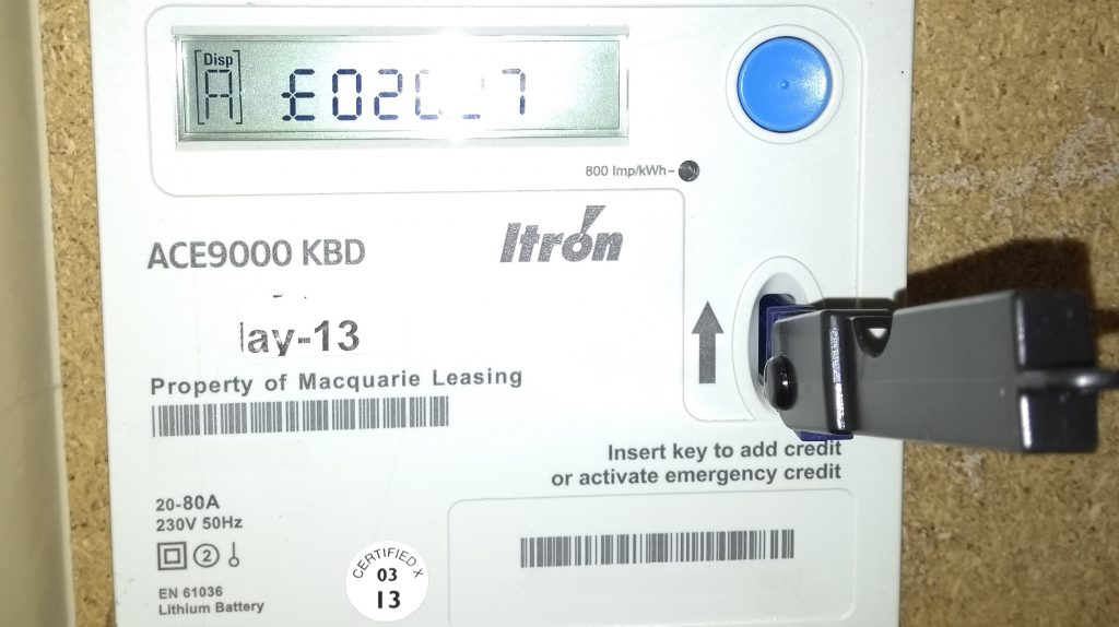Traditional electricity prepayment meter with key inserted